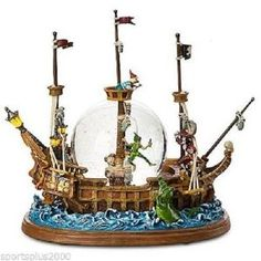 Amazon.com: Peter Pan Pirate Ship ~ Disney Musical Motion & Lighted Snow Globe ~ Brand New in Original Box ~ in Mint Condition!: Home & Kitchen