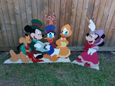 "Mickey Mouse & Friends Caroling - Yard Art custom-made-to-order be ""ART de YARD"". Mickey Mouse & Friends Caroling – Yard Art custom-made-to-order be ""ART de YARD""… Mickey M Disney Christmas Decorations, Diy Christmas Village, Christmas Yard Art, Mickey Mouse Christmas, Christmas Wood, Christmas Crafts, Mickey Halloween, Wood Yard Art, Disney Diy Crafts"