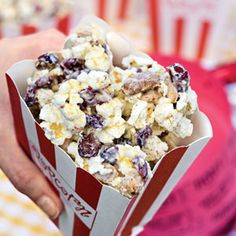 Gold-Dusted White Chocolate Popcorn    1 (3.3-oz.) bag butter-flavored microwave popcorn, popped   1 cup salted mixed nuts  1 cup dried cranberries   1 (12-oz.) package white chocolate morsels   1/2 teaspoon ground cinnamon   Edible gold dust