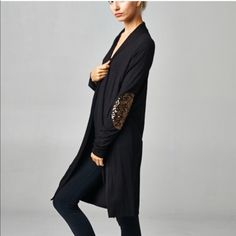"♨️2xHP♨️Long Cardigan Sequin Sparkly Elbow Patches Solid Black MidLength open Cardigan sweater with bronze gold sequin elbow patches.   95% Rayon 5% Spandex   Approximate Measurements Laid Flat:  Large 23"" armpit to armpit 45"" neck to hem  Medium 22"" armpit to armpit 46"" neck to hem  Small 21"" armpit to armpit 47"" neck to hem  I'm 5'6"" 150lbs wearing the Large in pictures.    This is a fun, unique cardigan that will be sure to draw extra attention! SAME OR NEXT BUSINESS DAY SHIPPING Callie…"
