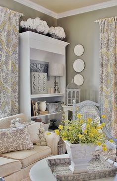Farmhouse Style - I love this color on the wall.  the tapestry for curtains and accent pillow is so lovely!