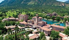 The Broadmoor Hotel Colorado Springs. Situated between mountain ranges, The Broadmoor is breathtaking. People love it in the summertime but we visited in the winter. Gorgeous Christmas decor and a beautiful drive to Breckinridge is minutes away.  We luv the area and this hotel! :) --Melly Mel  #travel #hotels #colorado
