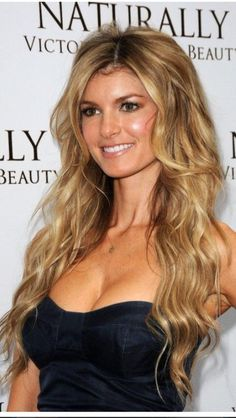 Long wavy hair. I love the shorter layers around the face.
