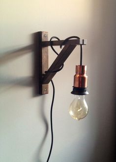 Light Up A Space For Less By Buying Your Own Cheap Lamp Cord Sets, Wooden Shelf Brackets, Copper Bushings And Edison Bulbs To Diy This West Elm Copper Light And Angler Sconce, That When Added All Together Would Cost A Little Under 90 To Buy. Copper Lamps, Copper Lighting, Pendant Lighting, Wooden Shelf Brackets, Wooden Shelves, Shelf Bracket Light, Book Shelves, Wall Brackets, Floating Shelves Bathroom