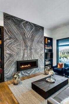 Aria Stone Gallery Silver Wave Fireplace #naturalstone #fireplace #marble #quartzite #blackfireplace #modernfireplace #fireplacedesign #interiordesignideas #blackandwhite #silverwave #livingroom #stone