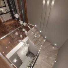 schody kamienne w domu, oświetlenie klatki - lampy przy schodach