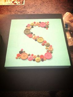 Button monogram on painted canvas