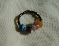 ring with colourful little stones and beads through elastic string (one size fits all!)---δαχτυλίδι με χάντρες σε ελαστική πετονιά