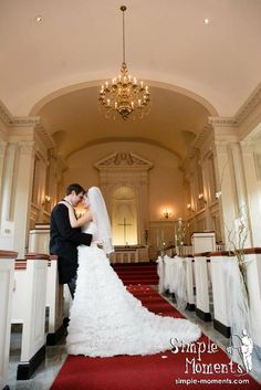 bride and groom pose in church