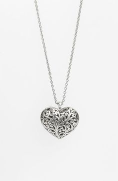 Lois Hill Long Pendant Necklace:   Signature hand-carved scrollwork amplifies the romance of a bloused heart pendant tipping a shiny, handcrafted chain.