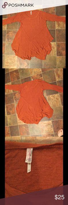 Free people burnt orange flowy top Burn orange SUPER soft 3 quarter sleeve flowy top. Looks great with skinny jeans and black combat boots! Free People Sweaters Crew & Scoop Necks
