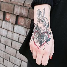 rabbit flower and heart tattoo on the hand