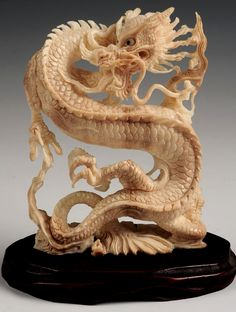 An Early 20th C. Carved Ivory Figure of a Dragon. Sells March 19, 2015.