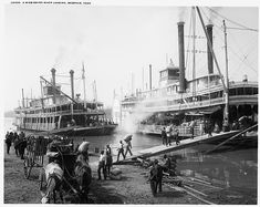 This American nautical history photograph shows two Mississippi River steamboats, Belle of the Bends and Belle of Calhoun, being loaded with cargo by dock workers in Memphis, Tennessee. Published by the Detroit PublishingCo. Old Pictures, Old Photos, Vintage Photos, Nice Photos, Vintage Photographs, Keith Richards, Steam Boats, Old Boats, Small Boats