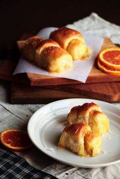 Irene's Orange Brioche rolls. Made with sour cream and butter, these rolls are filled with a sweet mixture of orange zest & coconut before being baked, then soaked in a sweet orange glaze.