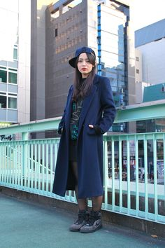 This is way too cool. Really like the combo of structured coat with a cap + sneakers.