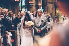 Photography by Howard's Photo -Walking down the aisle