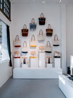 Display wall of handbags. (This Natural World / Journal / Scout / Seattle). #retail #merchandising #accessories #wall #display