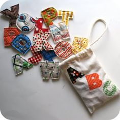 Alphabet letters made from fabric scraps.