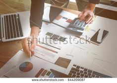 business documents on office wooden table with smart phone and digital tablet and graph financial and calculator. business financial concept.