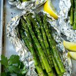This recipe for grilled asparagus in foil is tender fresh asparagus stalks cooked in foil packets with butter, seasonings and herbs. Throw these foil packs on the grill or bake in the oven for an easy side dish! Grill Asparagus In Foil, Grilled Asparagus Recipes, Baked Asparagus, Grilled Steak Recipes, How To Cook Asparagus, Fresh Asparagus, Grilled Veggies, Asparagus On The Bbq, Grilled Vegetable Recipes