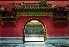 "A view of the Nine-Dragon Screen beyond the Gate of Imperial Supremacy. The Nine-Dragon Screen is a glazed wall decorated with nine dragons. From ""Palace Architecture,"" a volume of the Library of Ancient Chinese Architecture."
