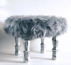 ▲Custom built grey faux fur stool with finished silver wooden legs. The stool…