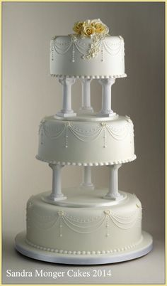 Classic Pillar Wedding Cake with piped swags and flowers.