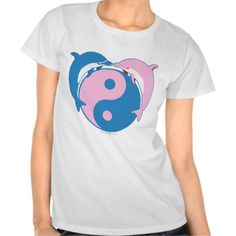 "Yin Yang Dolphins Blue/Pink T Shirt The dolphin meaning is connected with themes of duality. It has to do with the dolphin being both fish and mammal. It is both of the water, and an air breather. Ergo, dolphin symbolism talks to us about ""being in two worlds at once."" Indeed, the dolphin is a great conveyor of the concept of yin and yang. The image of two dolphins together is symbolic of harmony within the Chinese yin-yang philosophy."
