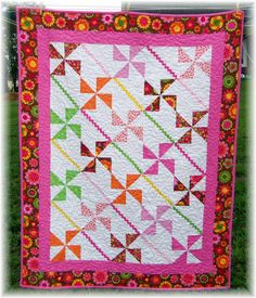 Fun Floral Lap Quilt for Girls. Love the bright colors in this one.