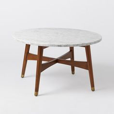 """Reeve Mid-Century Coffee Table - Marble with pecan finish legs and brass feet.  30""""diam. x 18.5""""h.  $530"""