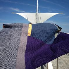 "Heidi Parkes with her quilt, ""Night and Day,"" in front of the Milwaukee Art Museum. #handquilted"