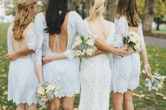 Bride with all her bridesmaids! love the bridesmaids dressed and free spirited nature of the wedding!