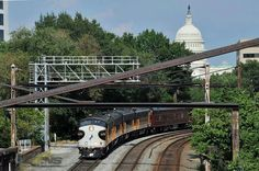 The NS office car train departs Washington D.C. with our Nation's Capitol watching in the background.