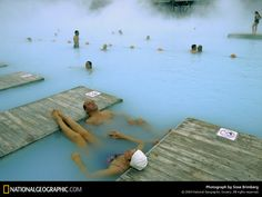 """Blue Lagoon, Grindavik, Iceland, 1998 Geysers, hot springs, and steam vents provide geothermal energy that heats 80 percent of Icelandic homes. In the Blue Lagoon, bathers from around the world come seeking the supposed healing properties of the waters.  (Photograph shot on assignment for, but not published in, """"In Search of the Vikings,"""" May 2000, National Geographic magazine)  蓝湖,格林达维克,冰岛,1998 间歇喷泉、温泉和蒸汽喷发口提供了能温暖80%冰岛家庭的地热能。来自世界各地的寻求传说中的水疗的人来到蓝湖入浴。"""