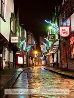 This is the Shambles in York. One of the most famous streets in England and one that is popular with tourists. In the early years it was used by butchers to display meat and that is where the name Shambles originates from. The image was taken during the Christmas period and you can see the Christmas trees on the wall's of the buildings. Its a very Charles Dickens scene and looks great as a Christmas card.