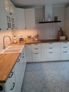 Wood tops, white cabinets & Moroccan floor