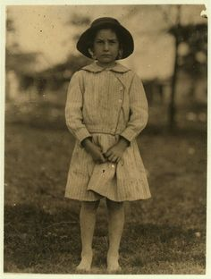 Willie Cherry, a 6 year old helper in Massey Hosiery Mill, Columbus, Ga. She has been going to school and helping her step-brother, Lawrence Webb, regularly after school. Her mother has recently stopped her working as it hurt her eyes. Lawrence, 12 years old, has been working nights there. Columbus, Georgia May 1913 Photo by Lewis Hine