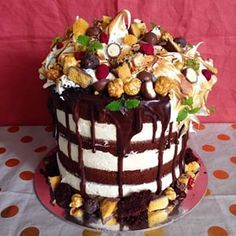 Oh my! I think I might have been a bit sinful today...this is a custom order cake for a 30th birthday! Layers of salted caramel mousse, moist dark chocolate cake, dark choc ganache drizzle topped with toasted meringue, caramel and choc popcorn, crunches, maltesers, raspberries and assorted micro herbs, all atop a crunchy biscuit base! I am absolutely petrified that this one is going to collapse before pick-up!! Here's hoping it doesn't! Cake inspired by @andybowdy #monster #meringue…