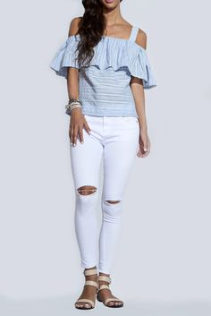 White skinny jeans with rips in the knees. Model is wearing: Size Small - Hand wash cold - Runs true to size Lux Tip: Pair these jeans with a off the shoulder blouse for a casual cool look