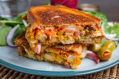 Moroccan Chicken Manchego Melt Recipe : A grilled cheese sandwich stuffed with Moroccan seasoned grilled chicken, green olive and preserved lemon tapenade, pickled red onions and spicy harissa along with plenty of melted manchego cheese! Grilled Sandwich, Soup And Sandwich, Sandwich Recipes, Chicken Sandwich, Empanadas, Burritos, Tapas, Moroccan Chicken, Homemade Pickles