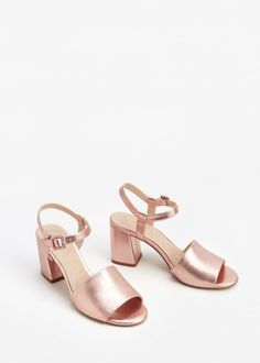 Get ready to bust a move on the dance floor with these lustrous metallic pink salmon ankle-cuff block heels.