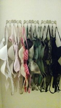 Worried about your padded bras getting squished? Fret no more. Hang your bras on a series of hooks behind your closet door for quick storage without the risk of any misshaping.