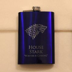 Game of Thrones blue house of stark flask. Totally want one!