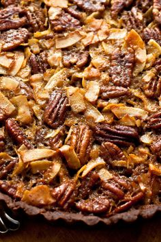 NYT Cooking: This dessert adds coconut and pecans to a buttery chocolate shortbread crust, which is baked it until the whole thing is glossy and crisp on top. It tastes a little like pecan pie and a little like a candy bar — which is to say perfect.