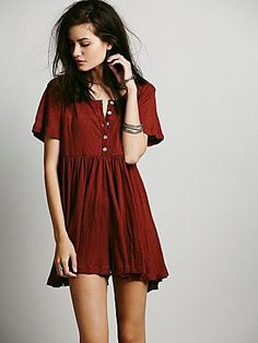 Who's That Girl Romper | Semi-sheer short sleeve babydoll romper with buttons down the front. Elastic waistband. *FP Beach is a collection that embodies the free spirit of the seaside lifestyle with casual knit dressing, lightweight layers and effortless shapes. **Special Note: The Sedona Red color is more orange than it appears online.