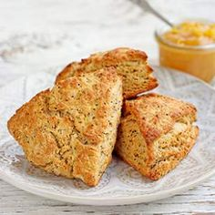 Lemon-Poppy Seed Scones | No bakery degree required for this recipe: these healthy lemon-poppy seed scones are as easy to make as a batch of muffins. White whole-wheat flour adds a boost of fiber, and just enough butter gives them great flavor and texture without going overboard on calories. For a sweeter scone, drizzle with the optional scone glaze.