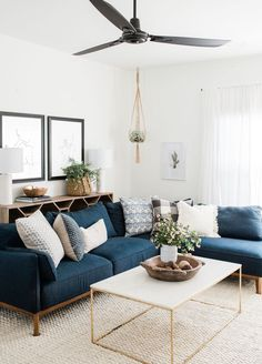 modern boho living room decor with blue velvet sofa and gold coffee table, navy sofa and boho pillows in living room design decoration Step Inside an Austin Home That Pairs Cozy Neutrals With Loads of Art Boho Living Room, Living Room Modern, Interior Design Living Room, Cozy Living, Blue Couch Living Room, Living Room Tables, Navy Blue Living Room, Living Room Decor Blue Sofa, Blue Home Decor