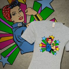 EVERYDAY HERO TEE - Shirt features a re-imagined illustration of the American icon, Rosie the Riveter. Designed to empower, inspire and celebrate. Available in selected colors. #rosie-the-riveter, #tshirt, #tshirts, #tees, #teeshirt, #latina #hero, #heroine, #heroines, #girlpower #we-can-do-it, #ethnic