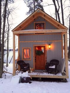 Family (with a single mom, with help from friends) Builds Tiny Off-Grid Lakeside Cabin Near Columbus, Ohio - porch | Powered by Gas Generator | Tiny Homes